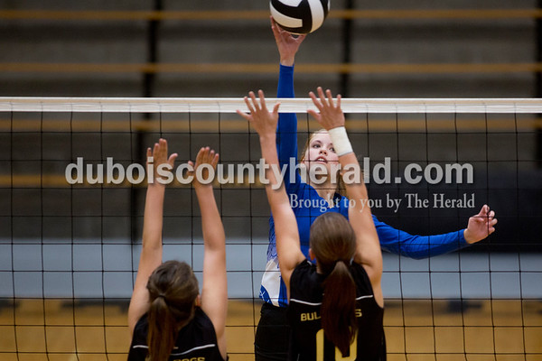 Sarah Shaw/The Herald Northeast Dubois' Molly Lueken hit the ball over the net while Cannelton's Kelsey Marshall and Makenzie Reed defended during Thursday's Class 1A sectional semifinal against Cannelton in French Lick. Northeast Dubois won 3-0.
