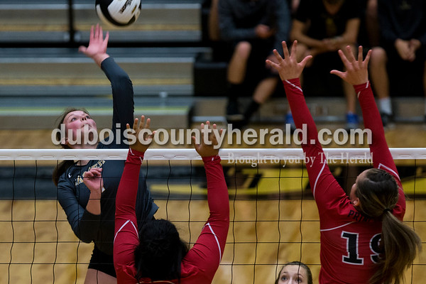 Jasper's Maddie Edwards spiked the ball during Thursday night's Class 3A sectional quarterfinal against Princeton at Jasper High School. Jasper swept Princeton 25-19, 25-19, 25-16.   Alisha Jucevic/The Herald