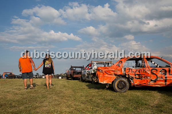 Greg Ubelhor and his fiancé Cheyenne Harris, both of of Ferdinand, held hands as they walked to go watch the truck division of the demolition derby in Boonville on Sept. 4. The couple hopes to get married during a demolition derby in the summer of 2017.