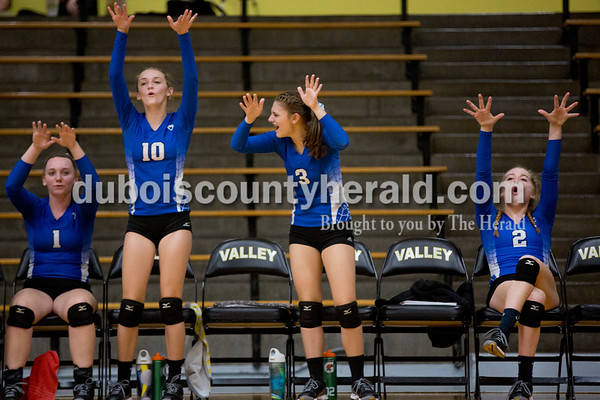 Sarah Shaw/The Herald Northeast Dubois' Chloe Terwiske, left, Taylor Dodd, Carly Terwiske, and Clare Mangin celebrated during Thursday's Class 1A sectional semifinal against Cannelton in French Lick. Northeast Dubois won 3-0.