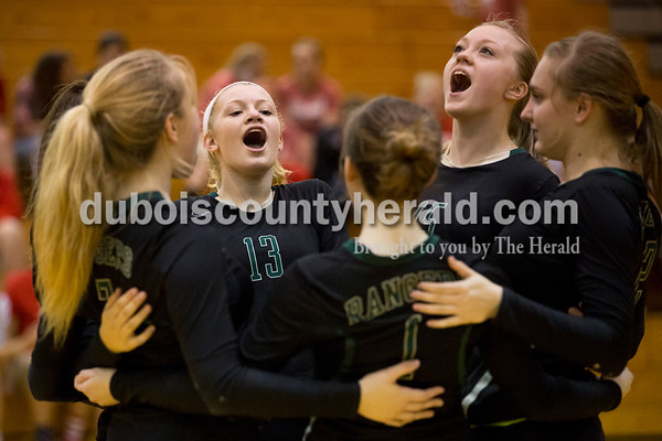 Forest Park volleyball players cheered on the court before a set during Thursday's 2A sectional volleyball game in Ferdinand. Tell City defeated Forest Park 3-1. Sarah Ann Jump/The Herald