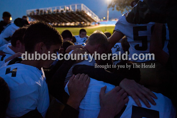 The Rangers huddled together for a prayer before the Class 2A sectional on Friday night against South Spencer in Reo. South Spencer defeated Forest Park 34-18 in the first round of the sectional.      Alisha Jucevic/The Herald