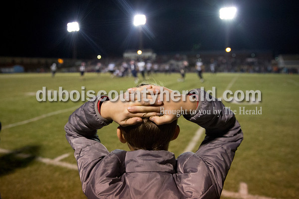 Southridge fan Cole Wirthwein of Huntingburg, 12, watched as the game was tied during the last minute of regulation during Friday's 3A sectional football game in Lincoln City. He said it was stressful to watch. Southridge defeated Heritage Hills 37-34 in double overtime. Sarah Ann Jump/The Herald