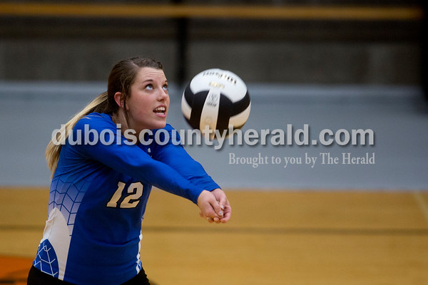 Sarah Shaw/The Herald Northeast Dubois' Megan Lueken bumped the ball during Thursday's Class 1A sectional semifinal against Cannelton in French Lick. Northeast Dubois won 3-0.