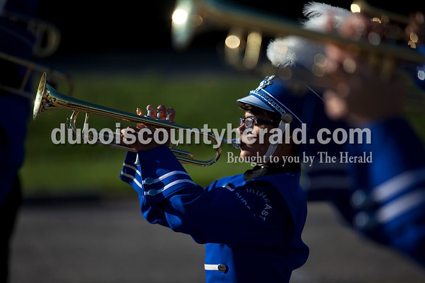 Northeast Dubois seventh-grader Maggie Poppe warmed up before Saturday's ISSMA Marching Band Scholastic Class state finals at Lawrence Central High School in Indianapolis.  Alisha Jucevic/The Herald
