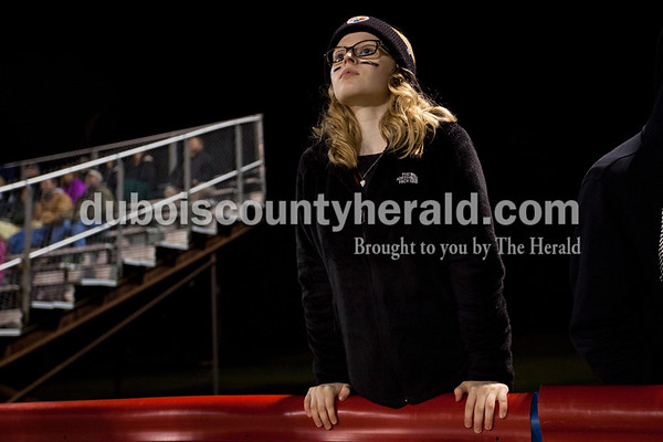 Forest Park High School junior Tatum Englert watched the Class 2A sectional on Friday night in Reo. South Spencer defeated Forest Park 34-18 in the first round of the sectional.       Alisha Jucevic/The Herald