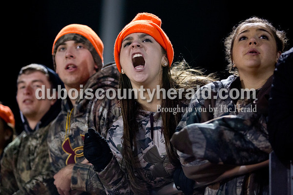 Jasper High School seniors Tyler Nottingham, from left, Jared Sermersheim, Corban Bell, and Sarah Smith watched as Jasper pulled within 24-14 of Harrison after ending the first half 17-0 during Friday's Class 4A sectional match against Evansville Harrison in Evansville. Evansville Harrison won 38-27.  Sarah Shaw/The Herald