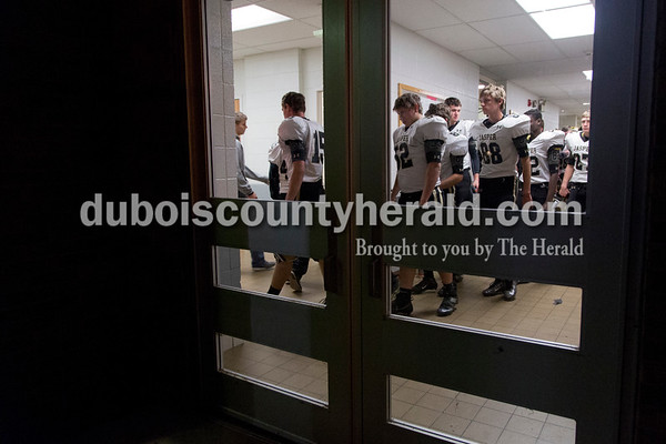 Sarah Shaw/The Herald The Jasper High School football team headed to the locker room following Friday's Class 4A sectional loss to Evansville Harrison in Evansville. Evansville Harrison won 38-27.