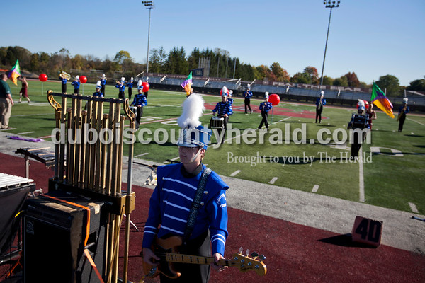 Northeast Dubois sophomore Jordan Baker played the bass during Saturday's ISSMA Marching Band Scholastic Class state finals at Lawrence Central High School in Indianapolis.  Alisha Jucevic/The Herald