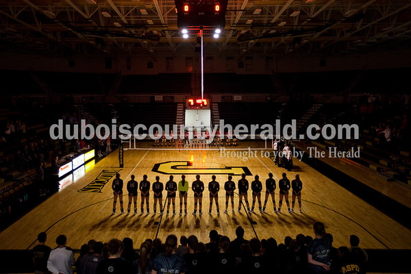 The Wildcats lined up for the national anthem before the first round of the Class 3A sectional against Princeton on Thursday night at Jasper High School. Jasper swept Princeton 25-19, 25-19, 25-16.   Alisha Jucevic/The Herald