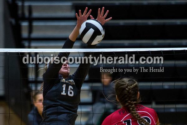 Jasper's Riley Merder blocked a spike from Princeton's Mallory Smith during Thursday night's Class 3A sectional quarterfinal at Jasper High School. Jasper swept Princeton 25-19, 25-19, 25-16.  Alisha Jucevic/The Herald