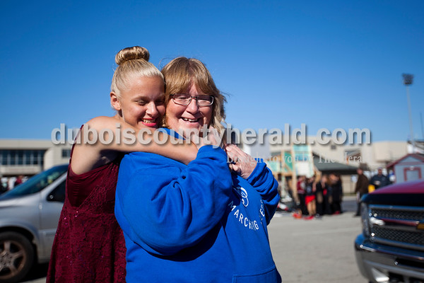 Dubois High School freshman Nikita Fischer hugged her mother Debbie of Dubois after Saturday's ISSMA Marching Band Scholastic Class state finals at Lawrence Central High School in Indianapolis. Alisha Jucevic/The Herald