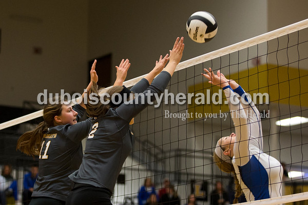 Jasper's Jocelynn Morrow, left, and Maddie Edwards blocked a shot by North Harrison's Cali Nolot during Saturday's 3A sectional championship volleyball match in Jasper. Jasper defeated North Harrison 3-1 for the title. Sarah Ann Jump/The Herald