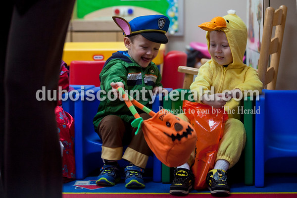Holland Elementary preschooler Emory Conway, left, and his classmate Matthew Brames sat together as they inspected their bags of candy after the preschooler's Halloween parade on Tuesday morning in Holland.   Alisha Jucevic/The Herald