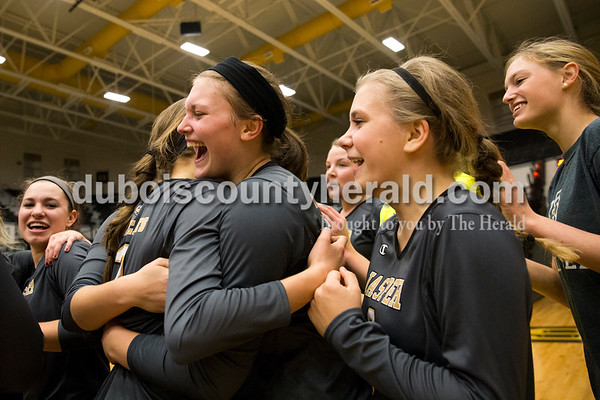 Jasper's Libby Bell, center left, and Maddie Edwards hugged as the team celebrated their win over North Harrison in Saturday's 3A sectional championship volleyball match in Jasper. Jasper defeated North Harrison 3-1 for the title. Sarah Ann Jump/The Herald