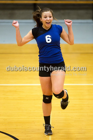 Northeast Dubois' Kendyl Heeke celebrated after scoring a point during Saturday's sectional semi-final volleyball match in French Lick. Northeast Dubois defeated Springs Valley 3-0. Sarah Ann Jump/The Herald