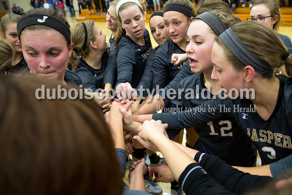 The Jasper volleyball team huddled during a timeout at Tuesday's 3A regional championship volleyball match in Evansville. Evansville Memorial defeated Jasper in four sets. Sarah Ann Jump/The Herald
