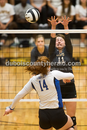 Jasper's Jocelynn Morrow blocked a shot by North Harrison's Lilly Hatton during Saturday's 3A sectional championship volleyball match in Jasper. Jasper defeated North Harrison 3-1 for the title. Sarah Ann Jump/The Herald