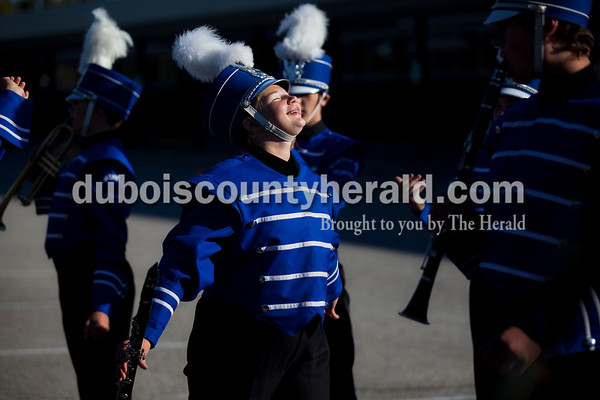 Northeast Dubois seventh-grader Jade Mundy and the marching band lined up for musical warm-ups during Saturday's ISSMA Marching Band Scholastic Class state finals at Lawrence Central High School in Indianapolis.   Alisha Jucevic/The Herald