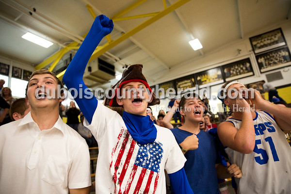 Northeast Dubois High School junior Chase Riecker, left, sophomores Logan Dodd and Mathew Jacob and junior Blake Ziegler cheered during Saturday's sectional semi-final volleyball match in French Lick. Northeast Dubois defeated Springs Valley 3-0. Sarah Ann Jump/The Herald