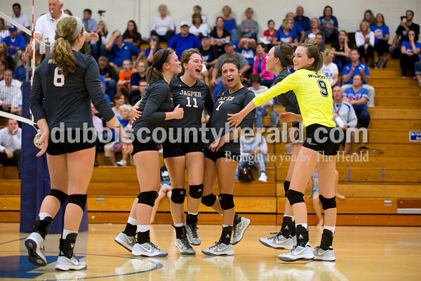 The Jasper volleyball team celebrated scoring a point during Tuesday's 3A regional championship volleyball match in Evansville. Evansville Memorial defeated Jasper in four sets. Sarah Ann Jump/The Herald