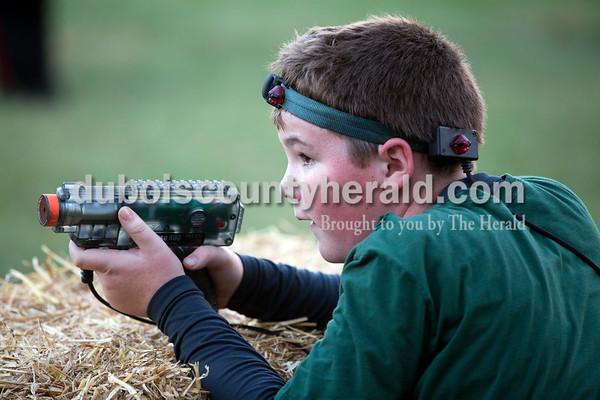 Sarah Ann Jump/The Herald Jax Bower of Jasper, 11, played laser tag at Teen Outback in Huntingburg on Saturday.