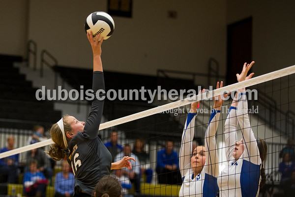 Jasper's Riley Merder hit the ball over the net as North Harrison' Emma Nokes and Keila Bennett jumped to block during Saturday's 3A sectional championship volleyball match in Jasper. Jasper defeated North Harrison 3-1 for the title. Sarah Ann Jump/The Herald