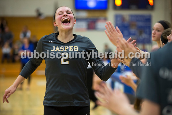 Jasper's Maddie Edwards high-fived her teammates as she came off the court during Tuesday's 3A regional championship volleyball match in Evansville. Evansville Memorial defeated Jasper in four sets. Sarah Ann Jump/The Herald