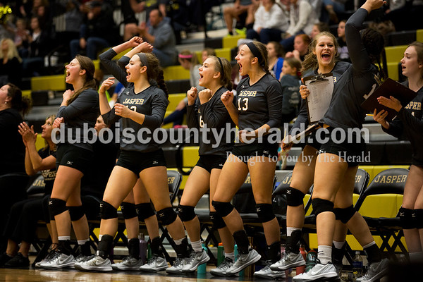 The Jasper volleyball team celebrated scoring a point during Saturday's 3A sectional championship volleyball match in Jasper. Jasper defeated North Harrison 3-1 for the title. Sarah Ann Jump/The Herald