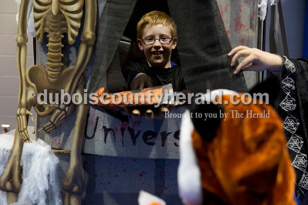 Sarah Ann Jump/The Herald Preston Hempfling of Jasper, 10, handed out prizes from inside a booth during Fright Night at Vincennes University Jasper Campus on Friday.