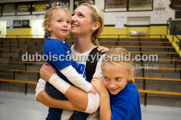 Northeast Dubois' Brooklyn Dodd received hugs from her cousins Ashtyn Kalb, 2, and Adalie Kalb, 8, both of Dubois, following Saturday's sectional semi-final volleyball match in French Lick. Ashtyn is also Brooklyn's god daughter. Northeast Dubois defeated Springs Valley 3-0. Sarah Ann Jump/The Herald