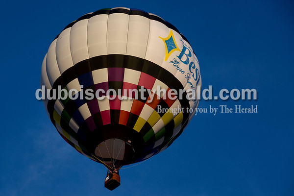 Sarah Shaw/The Herald Jerry Copas of Sellerburg flew a Best Home Furnishings hot air balloon over Ferdinand on Tuesday evening.