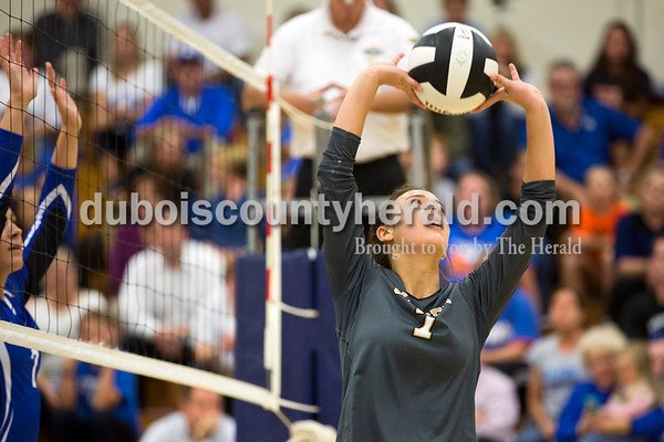 Jasper's Alexa Stenftenagel set the ball during Tuesday's 3A regional championship volleyball match in Evansville. Evansville Memorial defeated Jasper in four sets. Sarah Ann Jump/The Herald