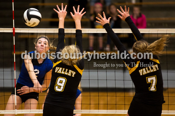 Northeast Dubois' Clare Mangin hit the ball passed Springs Valley's Bella Burton and Caitlyn Reynolds during Saturday's sectional semi-final volleyball match in French Lick. Northeast Dubois defeated Springs Valley 3-0. Sarah Ann Jump/The Herald