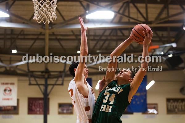 Forest Park's Sam Englert shot as Crawford County's Brent Smith attempted to block during Wednesday's game in Marengo. Forest Park defeated Crawford County 57-55. Sarah Ann Jump/The Herald