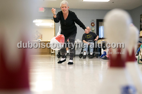 Sarah Ann Jump/The Herald Cathedral Health Care Center resident Katie Sears rolled a frozen 13-pound turkey during turkey bowling on Wednesday morning at Cathedral Health Care Center in Jasper.