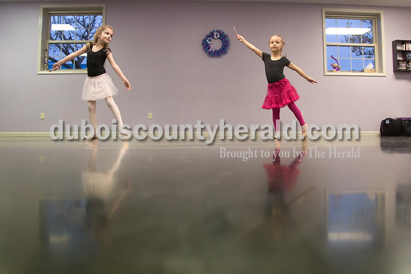 Sarah Shaw/The Herald Avery Adams of Petersburg, 6, left, and Leah Burden of Santa Claus, 5, practiced their dance during a rehearsal at Dance Central Academy of Performing Arts in Jasper on Thursday. Students from Dance Central Academy will be performing in the Evansville Children's Center for Dance Education's production of The Nutcracker at the Jasper Arts Center on Saturday at 3 p.m.