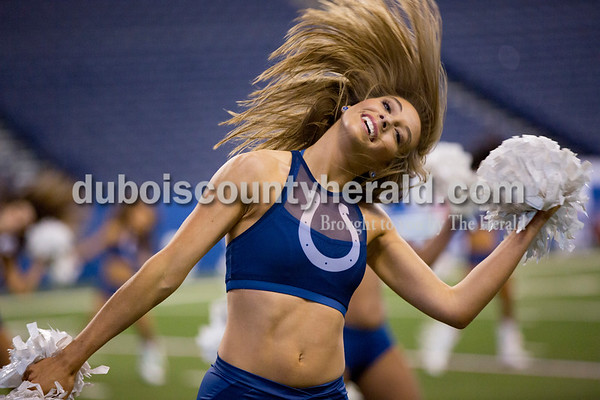 "Mallory Humbert of Jasper, 23, danced with the Indianapolis Colts Cheerleaders during an on-field rehearsal before the NFL game against the Tennessee Titans at Lucas Oil Stadium on Nov. 20. Mallory started taking dance lessons at age 3. ""I've always been dancing,"" she said. ""In the kitchen, the driveway, the grocery story, Lucas Oil Stadium, I've always been dancing."""
