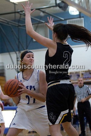 Northeast Dubois' Alex Dodson looked for a layup while Springs Valley's Jewel McCormick defended during Thursday's game against Springs Valley in Dubois. The Jeeps won 49-45.  Sarah Shaw/The Herald