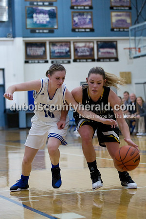 Northeast Dubois' Adison Denu tried to steal the ball from Springs Valley's Caitlyn Reynolds during Thursday's game against Springs Valley in Dubois. The Jeeps won 49-45.  Sarah Shaw/The Herald