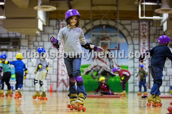 Sarah Ann Jump/The Herald Holland Elementary School second-grader Danyel Ellerbusch roller skated in physical education class at the school on Wednesday.