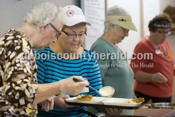 "Sarah Ann Jump/The Herald Volunteers from the Retired Seniors Volunteer Program, from left, Leona Hief, Shirley Greulich, Marlene Otto and LaVerne Lechner, all of Jasper, served the Monday afternoon meal as part of the Dubois County Community Meal program at Ozanam Hall in Jasper. ""It makes me feel good to do something for other people,"" said Shirley Greulich."