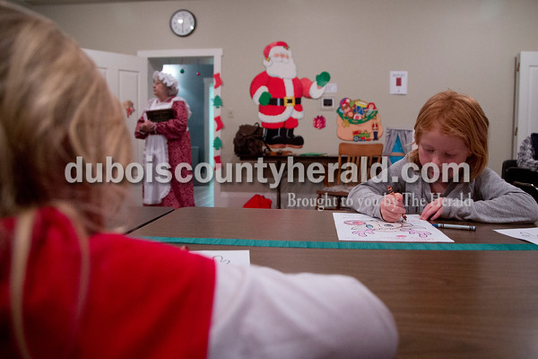 Sarah Shaw/The Herald Bailey Hagan of Jasper, 5, right colored a reindeer during a Letters to Santa Workshop at the Jasper Public Library on Tuesday evening. Mrs. Claus visited the library to share tales from the North Pole and help children write letters to Santa.