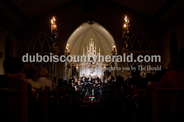 Sarah Shaw/The Herald The senior choir performed during an advent candlelight service Sunday night at St. James Lutheran Church in Holland. A freewill offering was designated for the family of Kathy Buse of Santa Claus, who has been affected by cancer.