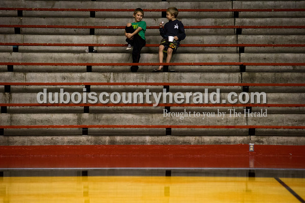 Southridge fans Izak Meyer, 7, left, and his brother Dexter, 5, both of St. Anthony, chatted as they watched Tuesday night's game at Memorial Gymnasium in Huntingburg. The Rangers defeated the Raiders 35-33.   Alisha Jucevic/The Herald