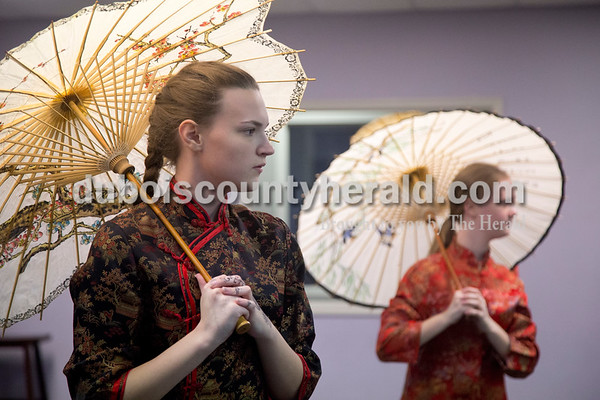Sarah Shaw/The Herald Ashleigh Kleiman of Jasper, 16, left, and Madison Hostetter of Jasper, 15, performed as Chinese dolls during a rehearsal at Dance Central Academy of Performing Arts in Jasper on Thursday. Students from Dance Central Academy will be performing in the Evansville Children's Center for Dance Education's production of The Nutcracker at the Jasper Arts Center on Saturday at 3 p.m.