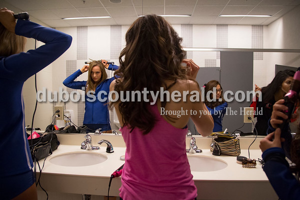 Colts cheerleaders Mallory Humbert, left, Ayda Coskunpinar, Yuka Shibano, and Ambria White curled their hair before the Nov. 20 Indianapolis Colts game against the Tennessee Titans at Lucas Oil Stadium in Indianapolis.