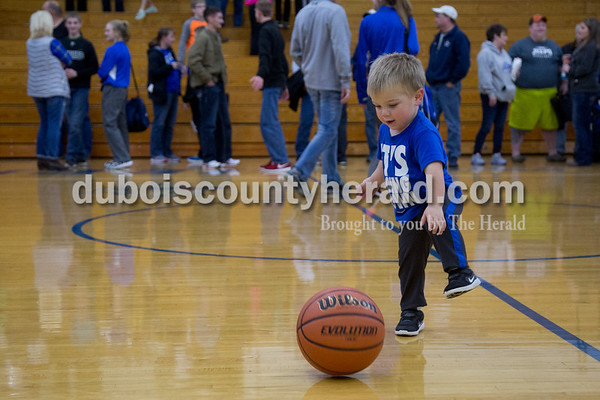 Luke Dalton of Dubois, 2, played with a basketball following Thursday's game against Springs Valley in Dubois. The Jeeps won 49-45.  Sarah Shaw/The Herald