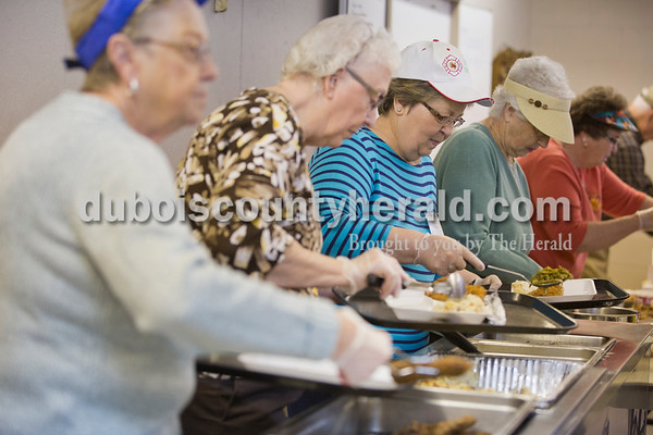 "Sarah Ann Jump/The Herald Volunteers from the Retired Seniors Volunteer Program, from left, Bev Schnell, Leona Hief, Shirley Greulich, Marlene Otto and LaVerne Lechner, all of Jasper, served the Monday afternoon meal as part of the Dubois County Community Meal program at Ozanam Hall in Jasper. ""I feel blessed when I see all these people come for their meals. Blessed that I can help,"" said LaVerne Lechner."