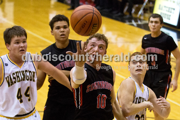 Southridge's Logan Seger reached for a rebound during Friday's basketball game in Washington. Washington defeated Southridge 63-47. Sarah Ann Jump/The Herald